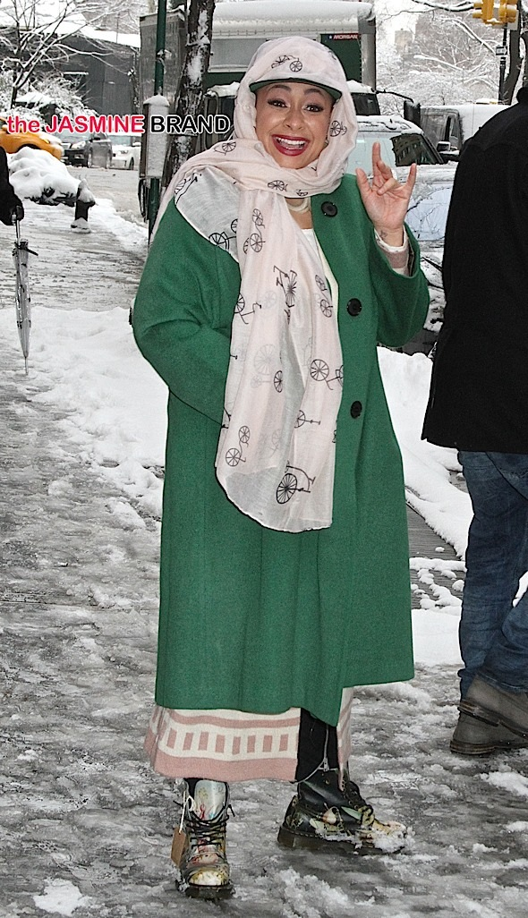 Actress/singer Raven Symone, wearing a pink scarf wrapped around her head, a green coat and Dr. Martens with the tag still on them, leaves 'The View' in the snowy NYC weather