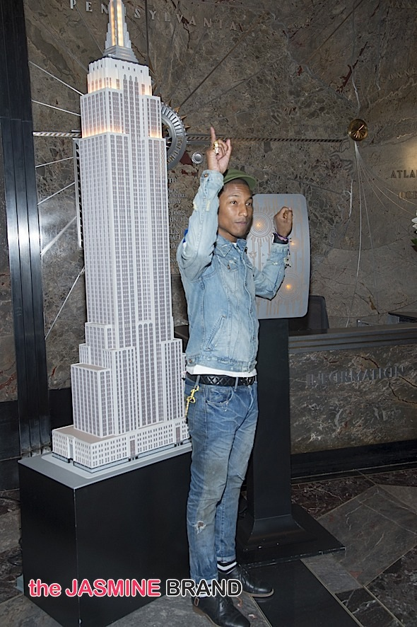 Pharrell Williams Lights the Empire State Building in Yellow for UN International Day of Happiness in New York City on March 20, 2015