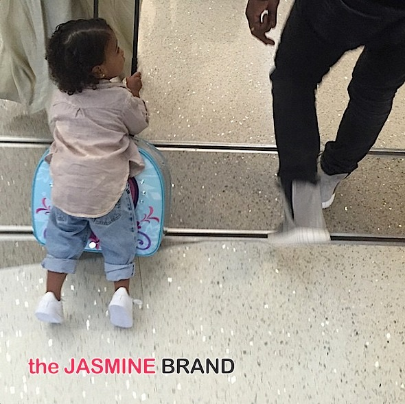north west rolls on luggage through lax-the jasmine brand