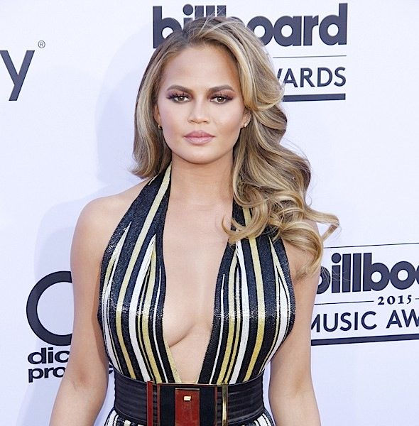 Chrissy Teigen Calls Out Racist Paparazzi: He asked if we evolved from monkeys!