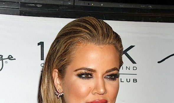 Ouch! Khloe Kardashian Gets Tramp Stamp Removed [VIDEO]
