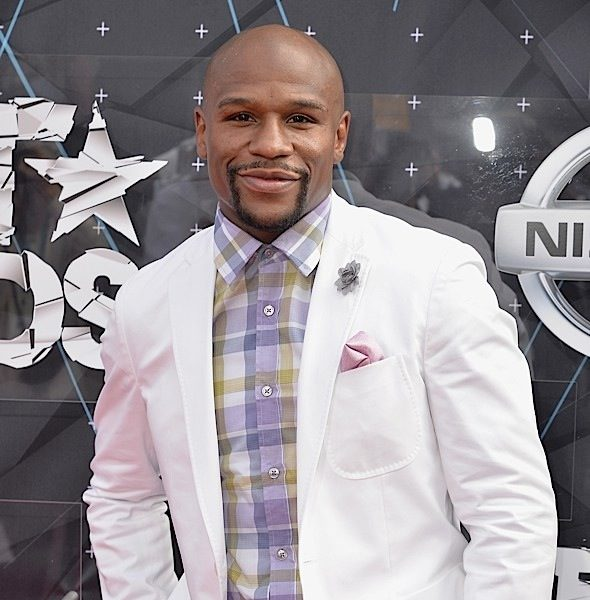 Floyd Mayweather Flaunts Wealth: You thought I couldn't read or write! [Photo]