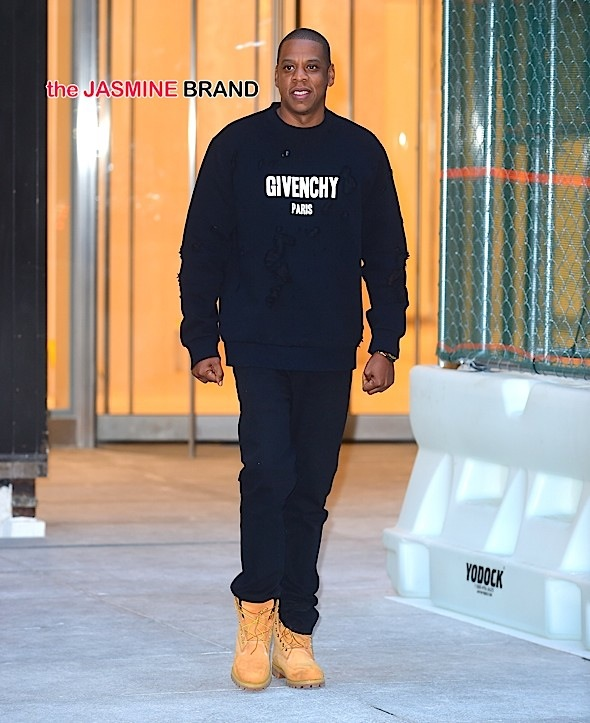 Jay Z has a big smile on as he steps out in NYC wearing Givenchy