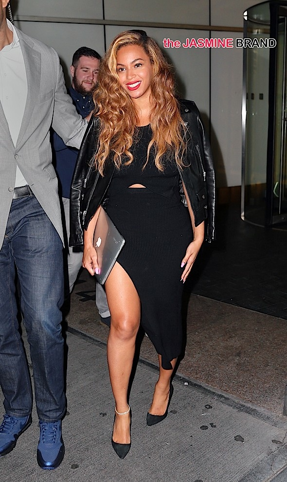 Beyonce Knowles holds a Macbook when departing her office in NYC