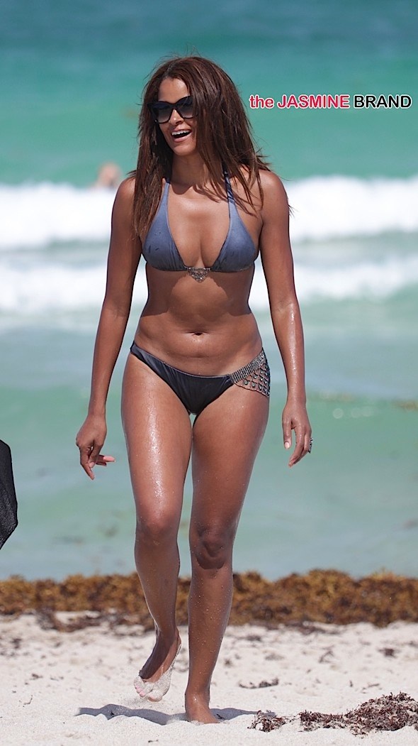 Claudia Jordan in a dark grey bikini at the beach in Miami