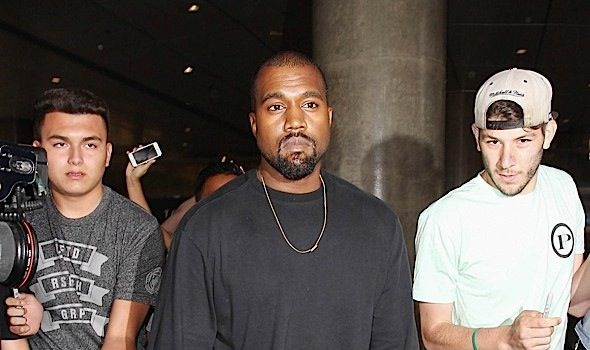 Kanye West Catches A Ride From Paparazzi [VIDEO]