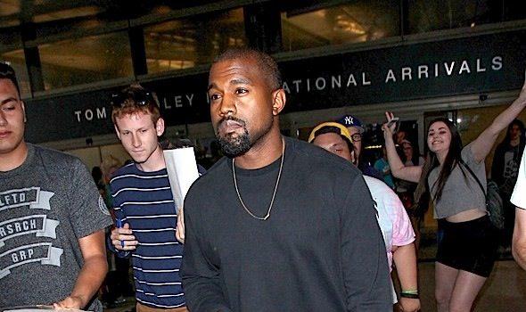 Kanye West Buys Paparazzi Yeezy Boost Sneakers [Photos]