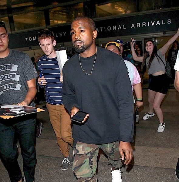 Kanye West Buys Paparazzi Yeezy Boost Sneakers [Photos]