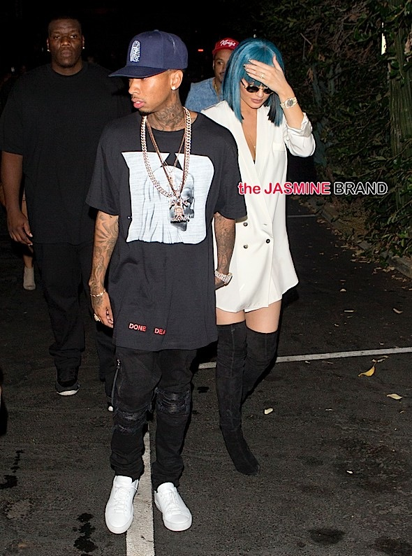 Kylie Jenner with bright Blue hair wearing a white shirt and knee high boots and sunglasses seen holding hands with her boyfriend Tyga leaving '1 Oak' Night Club in West Hollywood, CA