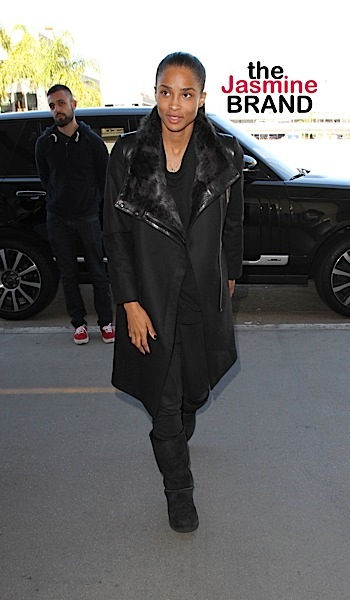 Ciara is all smiles as she catches a flight out of Los Angeles with her boyfriend, Seattle Seahawks quarterback Russell Wilson.