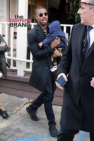 Michael B. Jordan cuddles a friend's baby while leaving Le Pain Quotidien in West Hollywood after lunch