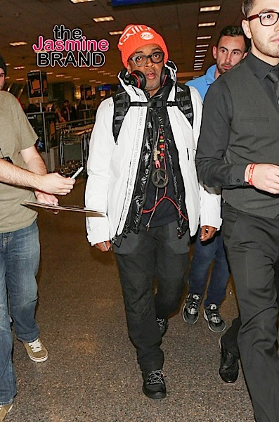 01/22/2016 - Spike Lee - Spike Lee Sighted Arriving at Salt Lake City International Airport on January 22, 2016 - Salt Lake City International Airport - Salt Lake City, UT, USA - Keywords: Black Shoes, Full Length Shot, Black Pants, Ring, Jewelry, White Coat, Black Headset, Headphones, Blue Sweatshirt, Black Coat, Necklace, Cross Pendant, Peace Sign Pendant, Eyeglasses, Glasses, Orange knit hat, Orange Knicks Basketball hat, Earrings, American film director, producer, writer, actor, 40 Acres and a Mule Filmworks, Vertical, The Sundance Film Festival, Celebrity Sighting, Celebrities, Arts Culture and Entertainment, Photography, Person, People, Utah, Candid, Walking, Travel Orientation: Portrait Face Count: 1 - False - Photo Credit: jmx / PRPhotos.com - Contact (1-866-551-7827) - Portrait Face Count: 1