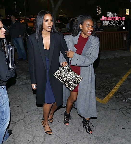 Kelly Rowland is escorted by a friend in Hollywood