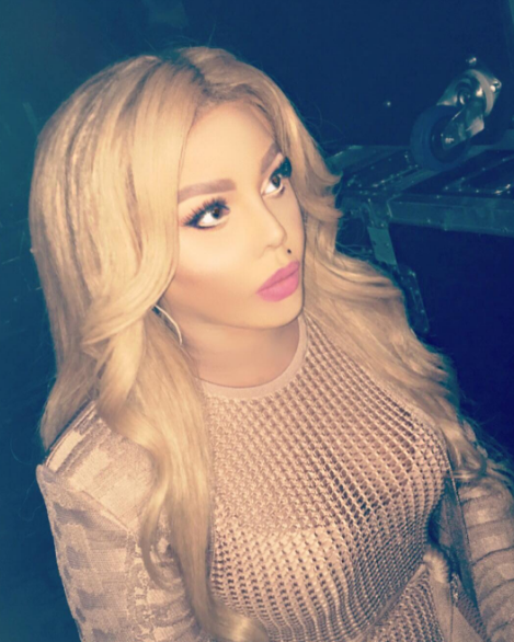 Lil Kim Drags Fan For Skin Bleaching Accusations: You miserable moron!