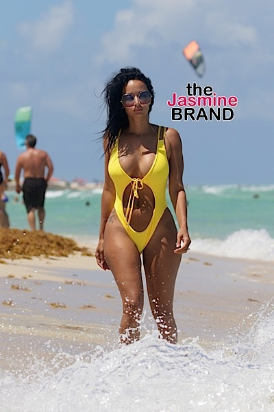 Draya Michele, 31, in a yellow one piece swimsuit in Miami