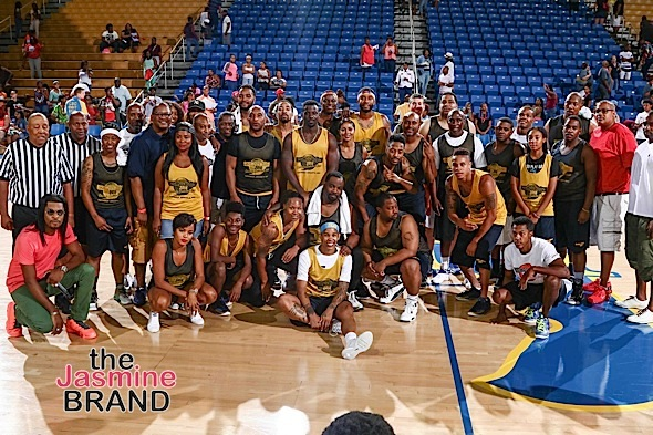 Celebrities and players pose for a group photo