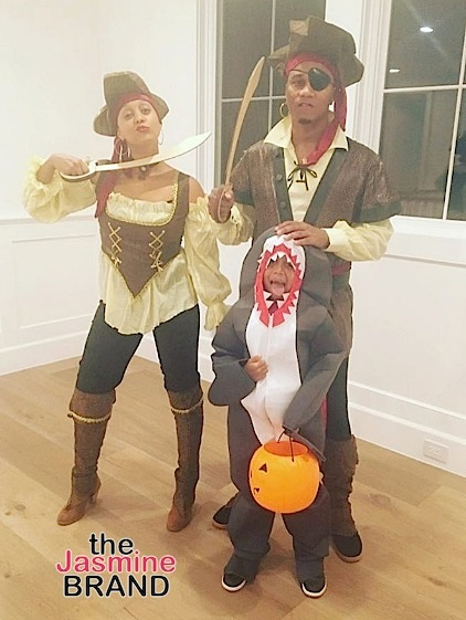 Tia Mowry, Cory Hardrict and son as pirates and a shark.