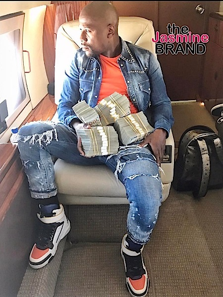 Floyd Mayweather Says He's Not Flaunting His Money, While Showing Off Stacks Of Cash: In A Recession, I Can Still Feed My Loved Ones!