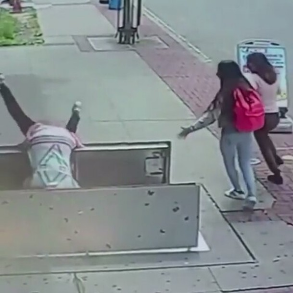 Ouch! Distracted By Her Phone, A Woman Flips Head First Falling 6 Feet [VIDEO]