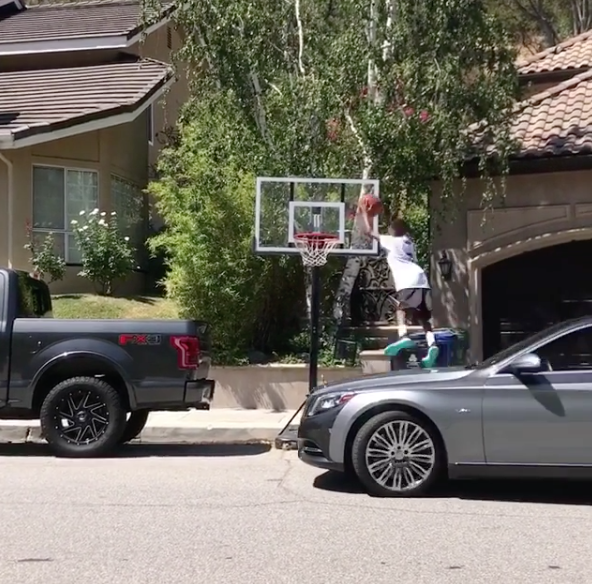 Yikes! Gilbert Arenas & Laura Govan's Son Jumps Off A Moving Car To Dunk A Basketball