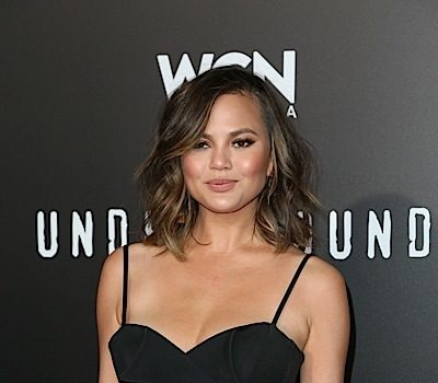Chrissy Teigen Says It Was 'Incredible' To Attend Inauguration Sober + Loses A Tooth While Eating A Fruit Rollup [WATCH]