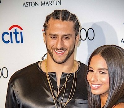 Colin Kaepernick's Girlfriend Shuts Down Anthem Rumors: He's not standing up!