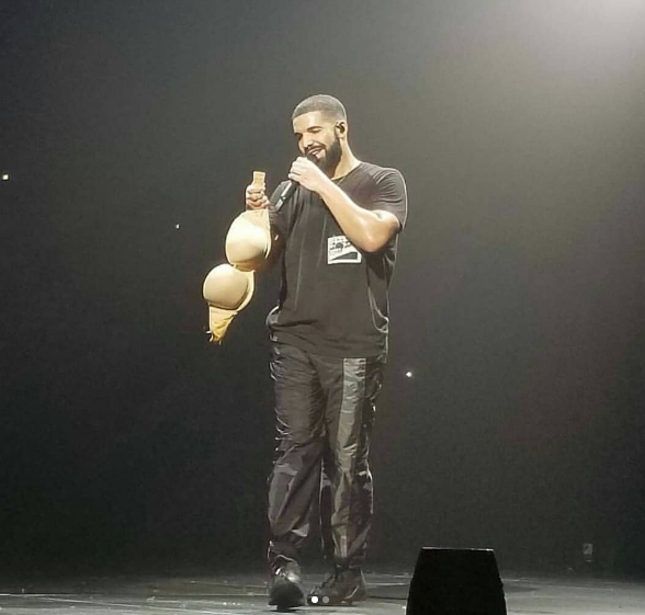 Drake - Fan Throws Bra On Stage, See His Reaction