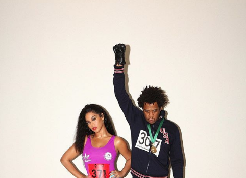 Beyonce Pays Homage Flo-Jo, Jay Z Throws Up Black Power Fist [Photos]