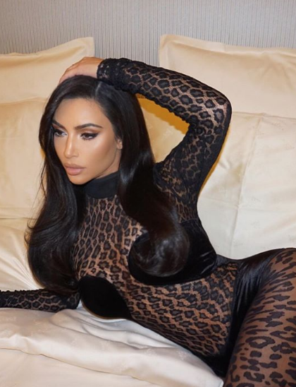25b6df57f32ea Kim Kardashian Stuns In Sheer Lace Bodysuit At Paris Fashion Week ...