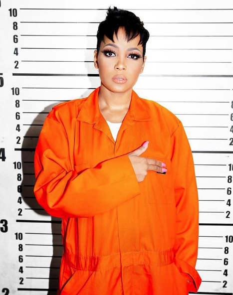 Monica Poses In Jail Attire, Hints New Music Is Coming