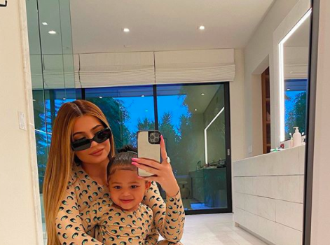 Kylie Jenner & Daughter Stormi Do The #FruitSnackChallenge [WATCH]