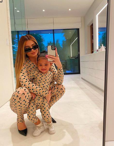 Kylie Jenner & Daughter Stormi Do The #FruitSnackChallenge [WATCH]