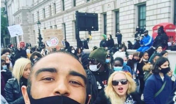 Madonna Protests W/ Crutches In London