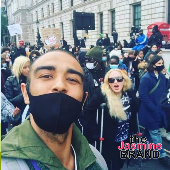 Madonna Protests W/ Crutches In London