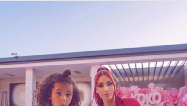 Kim Kardashian Rocks Red Hair & Matching Ensemble, While Posing with Son Saint West [Photos]