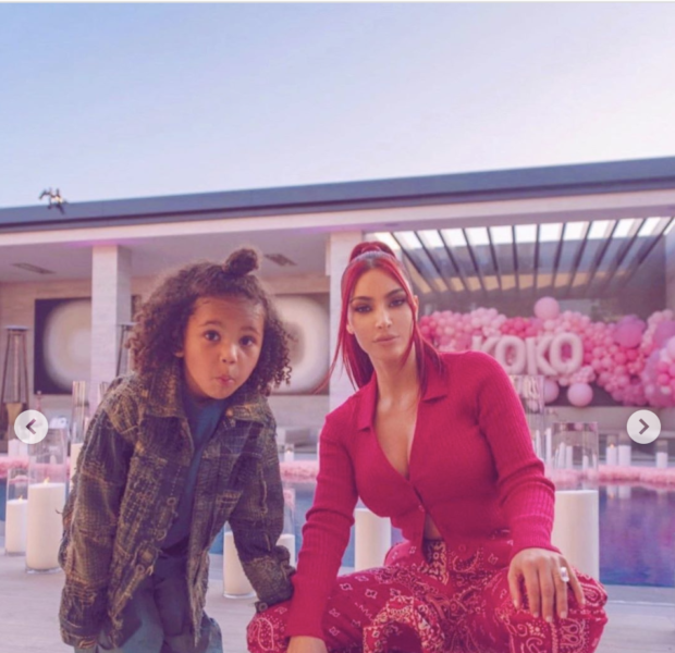 Kim Kardashian Rocks Red Hair & Matching Ensemble, While Posing with Son Saint West [Photos]