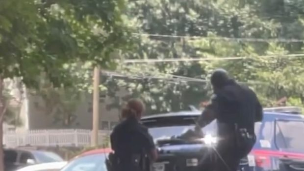 2 Atlanta Police Officers Suspended After Viral Video Shows One Kicking A Black, Handcuffed Woman In The Face As The Other Looks On [WATCH]
